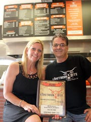 Kimberly Catania and Joseph Tringali are shown inside A Southern Bite, their new barbecue restaurant on the Seaside Heights boardwalk near Lincoln Avenue.