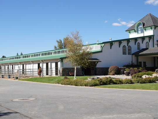 A frontal outside view of the Rancharrah equestrian center.