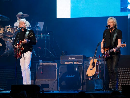 Justin Hayward (left) and John Lodge (right) remain the lead vocalists of the Moody Blues. Graeme Edge (partially obscured) is the band's original drummer.