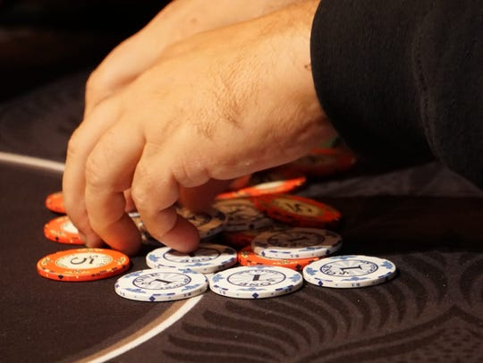 A player sorts his chips during a game of Texas Hold