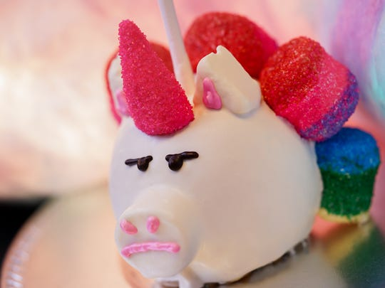 This stern-looking unicorn is actually a candied apple that will be available at Bin Bong's Sweet Treats at Pixar Pier.