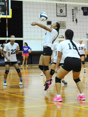 In this file photo, the George Washington Geckos and the Tiyan Titans face off in an Independent Interscholastic Athletic Association of Guam Girls Volleyball League match. The Geckos face the St. John's Knights in the semi-finals.