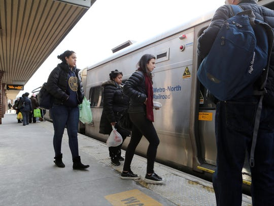 Young adults board a southbound train in White Plains