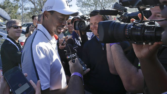 In this Feb. 5, 2015, file photo, Tiger Woods speaks to reporters after withdrawing during the first round of the Farmers Insurance Open golf tournament in San Diego. Woods won't be at Bay Hill next week for the Arnold Palmer Invitational. He still isn't ruling out the Masters. Woods said on his website Friday, March 13, 2015,  that he will not play at the tournament he has won eight times. (AP Photo/Gregory Bull,, File)