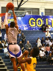 Canterbury's Berrick Jeanlouis dunks the ball against