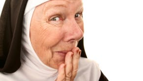 Funny Nun with Happy Shocked on her Face Stifling a Laugh