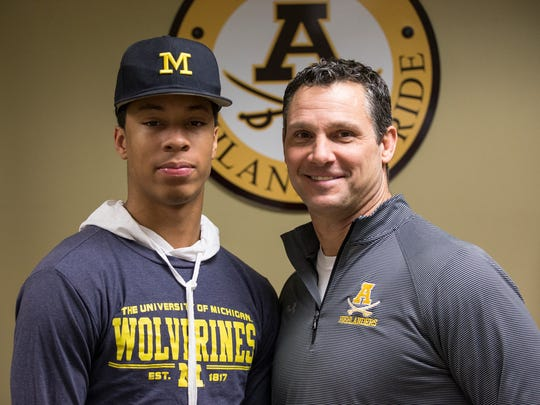 Michigan football signee Vincent Gray, left, with Rochester Adams head coach Tony Patritto on Wednesday.