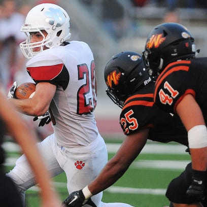 Brandon Valley's Chase Grode (20) carries the ball