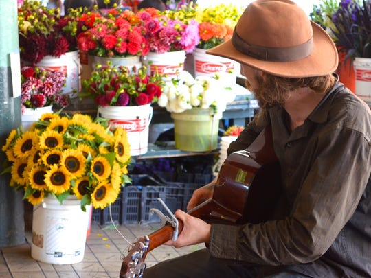 Dover is looking for buskers to play downtown. Here, a musician plays in Seattle's Pike Place Market, where street performers are an important part of the city's fabric and culture.