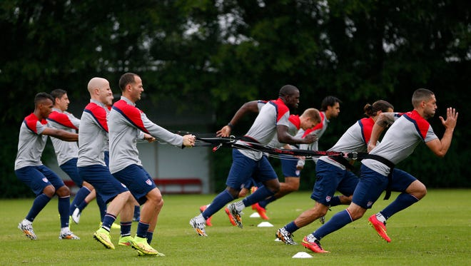 United States players work on resistance exercises during a training session at the Sao Paulo FC training center in Sao Paulo, Brazil, Tuesday, June 10, 2014. The U.S. will play in group G of the 2014 soccer World Cup.