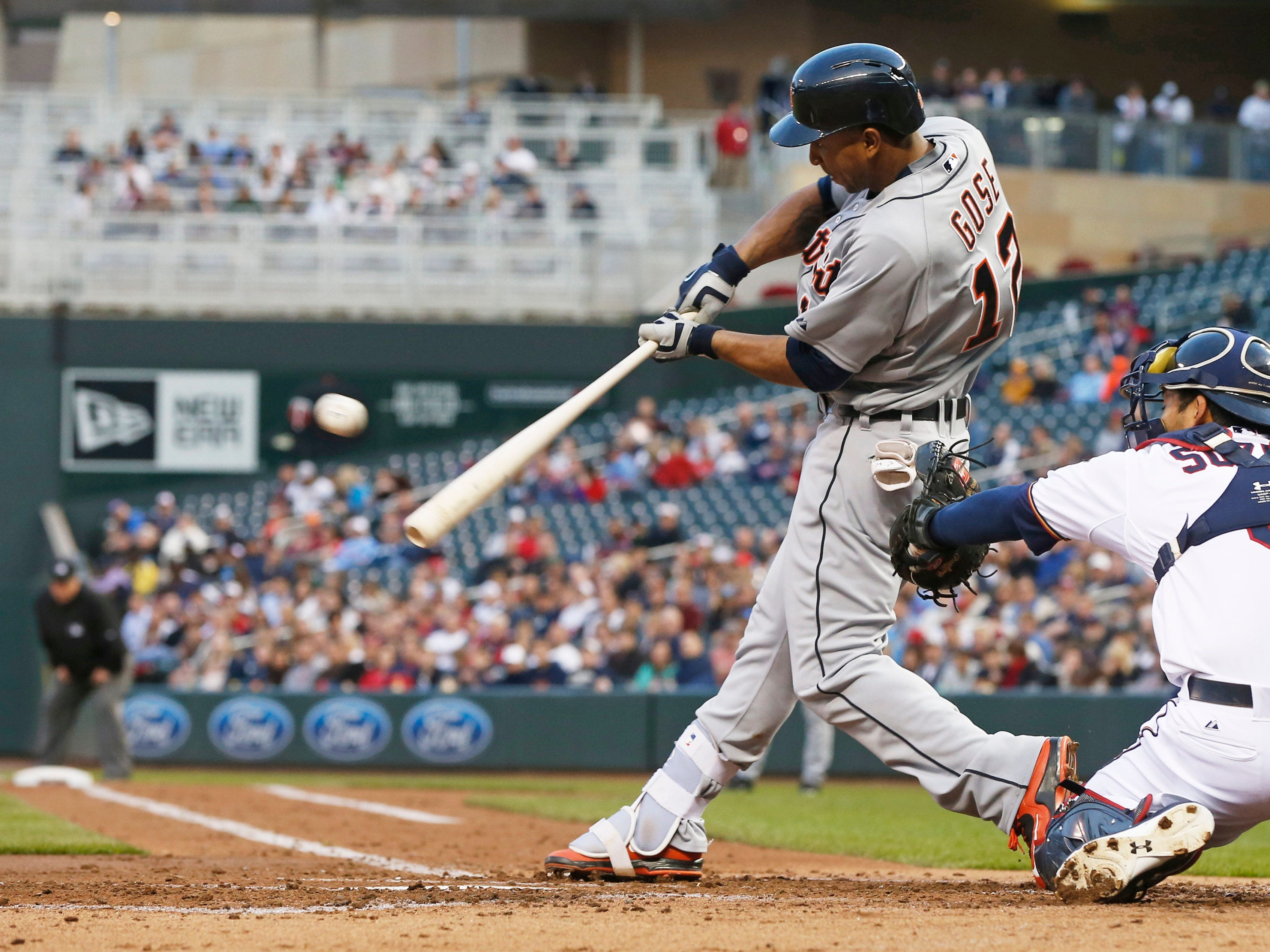 Detroit Tigers' Anthony Gose hits an RBI single in the third inning of a baseball game off Minnesota Twins pitcher Mike Pelfrey, Tuesday, April 28, 2015, in Minneapolis. (AP Photo/Jim Mone)