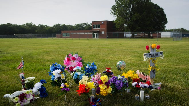 Flowers and memorials have been placed on the grounds at Bunn-O-Matic's Stevenson Drive facility in Springfield where three people were fatally shot Friday, June 26, 2020.