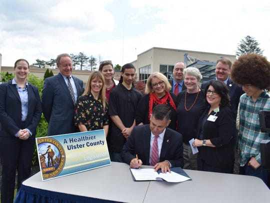 Ulster County Executive Mike Hein signs Tobacco 21,