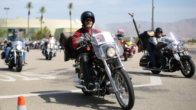 Some 280 motorcyclists, some carrying photos of those missing in action, leave the Spotlight 29 Casino in Indio for the Vietnam War Memorial in Washington D.C. on Wednesday.