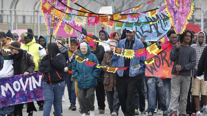 """Demostrators march from the north towards the middle of the 16th St. Viaduct, as dozens of community organizations participate in """"The Bridge Project,"""" in 2014, which asked residents of Milwaukee to unite to stop the violence. One group started marching from the north side of the Father Groppi Unity Bridge, also known as the 16th St. Viaduct, and another group started from the south end."""