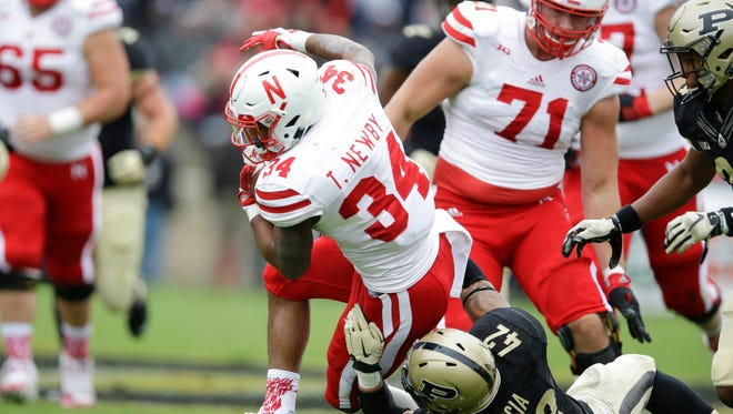 Nebraska running back Terrell Newby (34) is tackled by Purdue linebacker Andy James Garcia (42) during the first half of an NCAA college football game in West Lafayette, Ind., Saturday, Oct. 31, 2015.