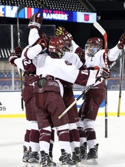 Don Bosco celebrates its second goal of the first period, scored by George Weiner, as the Ironmen routed the Hun School, 8-1, under the lights at Citi Field on Wednesday, Jan. 3, 2018. The teams used the same outdoor rink that the NHL's Winter Classic did when the Buffalo Sabres hosted the New York Rangers at the home of the New York Mets on New Year's Day.