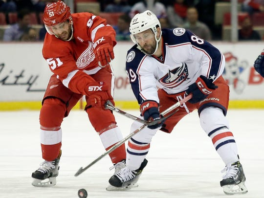 Red Wings center Frans Nielsen (51) tries to steal the puck from Blue Jackets center Sam Gagner (89) during the first period Friday at Joe Louis Arena.
