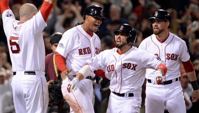 Boston Red Sox players celebrate Shane Victorino's grand slam against the Detroit Tigers in Game 6 of the ALCS at Fenway Park.
