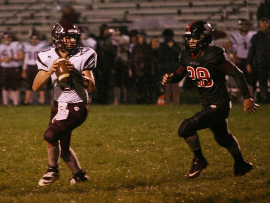 Stonewall Jackson's Dylan Vann goes after Stuarts Draft quarterback Garrett Campbell during the first half of Friday night's game against Stonewall Jackson in Quicksburg on Sept. 30, 2016.