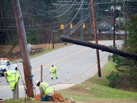 George Wallace Drive is closed as utility crews work to repair damaged power lines following a storm in Troy, Ala. on Saturday morning January 21, 2017.