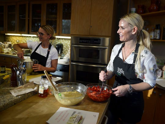 Fresno's newest health and fitness guru, Dina Juve, 44, right, leads a class on how to create a healthy hamburger with Chef Hillori Hansen on Thursday, April 20, 2017, at Whole Foods, in Fresno, Calif.  Along with owning a fitness studio, Juve is also a popular guest speaker, motivator and healthy food advocate.