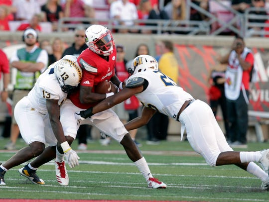 Murray State's Quincy Williams (13, left) sacks Louisville's Jawon Pass during a 2017 game.