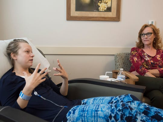 Serena Schwerdfeger, 19, receives treatment Tuesday for a rare autoimmune deficiency disease as her mom, Lisa Lewis, offers moral support at the Sacred Heart Cancer Center in Pensacola.