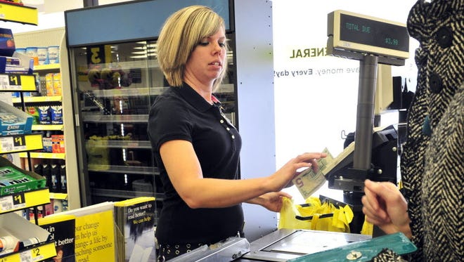 Store manager Kristy Denson rings up a customer at Dollar General on Gallatin in Madison January 22, 2013 in Nashville, Tenn.