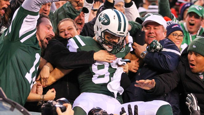 Jets fans celebrate with WR Eric Decker after his game-winning TD in OT.