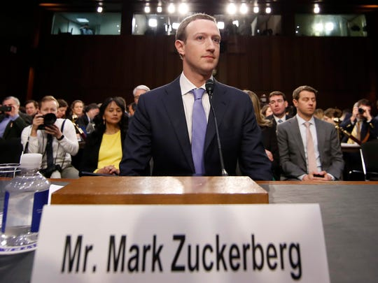 Facebook CEO Mark Zuckerberg takes his seat after a