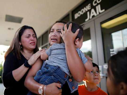 Riccy Enriquez Perdomo hugs her 11-month-old son, Rony, and is met by her sister Rita Enriquez as she is released from custody at the Boone County Jail in Burlington, Ky., on Thursday, Aug. 24, 2017. Riccy Enriquez Perdomo was released from county jail, after being arrested Aug. 17. Enriquez, had been granted legal status two times through DACA (Deferred Action for Childhood Arrivals) but was arrested at an immigration office in Louisville. She had gone there to post bond for another immigrant being held who was eligible for release.