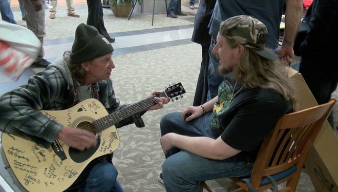 Veteran Lavon Langley gets instruction from Warrior Cry Music Project's Christopher Lee at the Jackson VA Wednesday.
