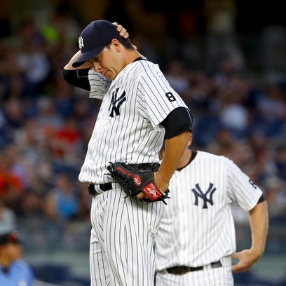 Yankees reliever Anthony Swarzak reacts in the 12 inning
