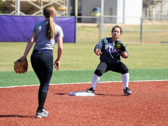 Wylie second baseman Halle Arbilera takes a throw from
