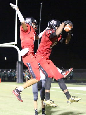Andre Polk (right) and Jeshaun Jones (left) celebrate Polks touchdown. South Fort Myers battled Venice in their Class 7A-12 Playoff game Friday night, November 13, 2015, at South Fort Myers.