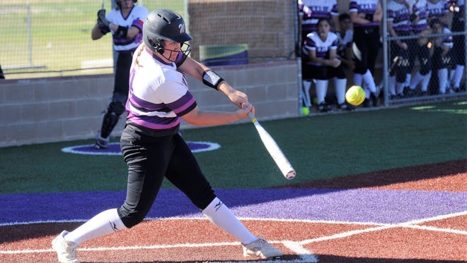 Wylie first baseman Bailey Buck (4) hits a double during the Lady Bulldogs' 10-0, six-inning home win against Snyder on Tuesday, March 20, 2018.