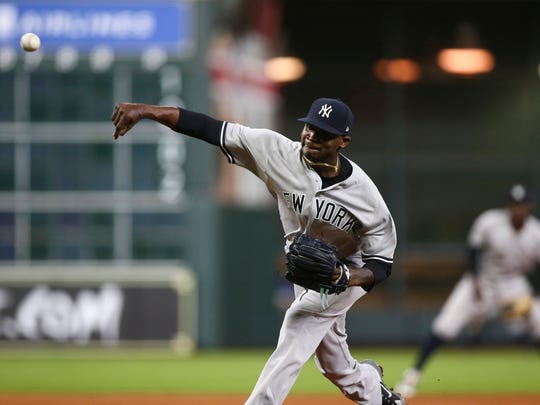 May 1, 2018; Houston, TX, USA; New York Yankees relief pitcher Domingo German (65) delivers a pitch during the second inning against the Houston Astros at Minute Maid Park.