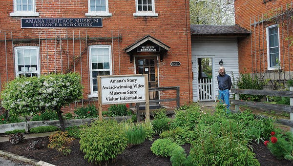 Lanny Haldy stands at the entrance to the Amana Heritage Museum in Amana. Haldy has been executive director of the Amana Heritage Society for 31 years and says the society and its mission are an integral part of the Amana Colonies.