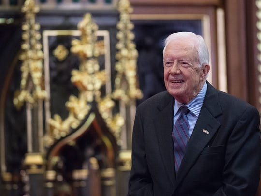 Former U.S. President Jimmy Carter receives delivers a lecture on the eradication of the Guinea worm, at the House of Lords on February 3, 2016 in London.