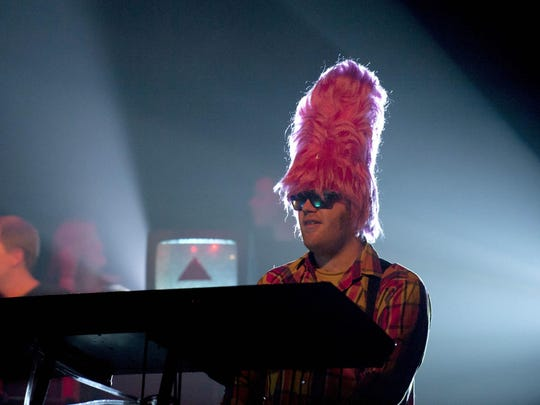 Pinky and the Floyd keyboardist Joe Kirchner wears a pink wig onstage.