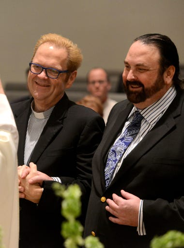 Rev. Jim Merritt, left, and Al Leach, are married by Rev. Lee Carlton on Tuesday at the Holy Cross Metropolitan Community Church on the first day of legal same-sex marriage in Florida. Leach and Merritt were excited to finally tie the knot legally after being together for over 20 years.
