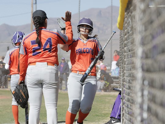 Eastlake's Cristina Cheadle gets a high-five from teammate Kasey Flores, left, after scoring against Parkland on Saturday.