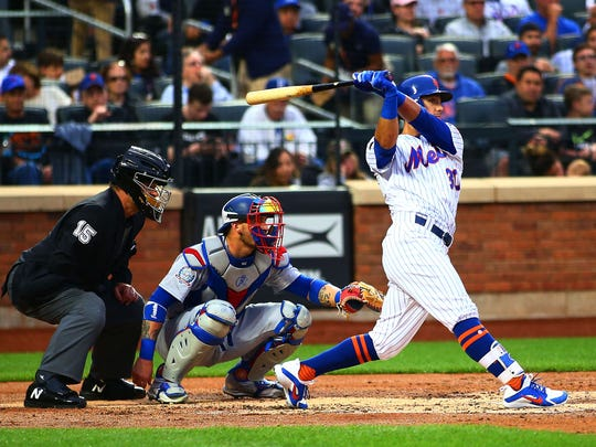 Jun 23, 2018; New York City, NY, USA; New York Mets center fielder Michael Conforto (30) doubles against the Los Angeles Dodgers during the second inning at Citi Field.