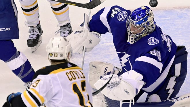 Tampa Bay Lightning goaltender Andrei Vasilevskiy (88) misses the puck shot from Boston Bruins center Charlie Coyle (13) during the first period of a Stanley Cup Eastern Conference playoff game in Toronto, on Sunday.