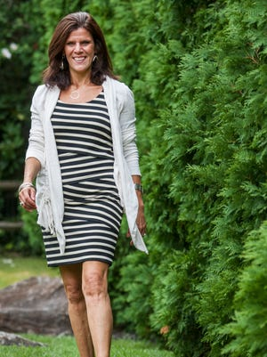 Debbie Kling, 49, of North Wilmington, wears a sleeveless dress from Loft with an Anthropologie jacket.