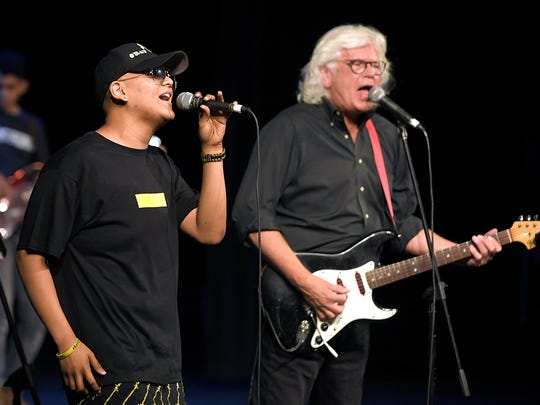 Centennial High School student Raymond Cruz perform with singer and songwriter Walter Egan during a benefit concert in his honor at Centennial on Saturday, May 6, 2017.