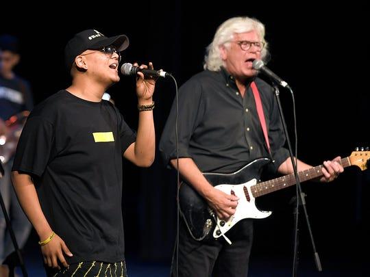 Centennial High School student Raymond Cruz perform
