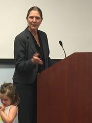 Attorney Kim Ferraro addresses an audience member during