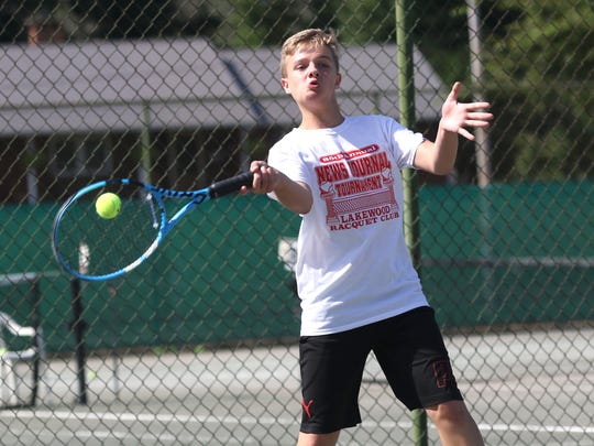 Tommy Secrist hits a forehand in Saturday's boys 16 final in the 85th News Journal/Richland Bank Tennis Tournament at Lakewood Racquet Club.